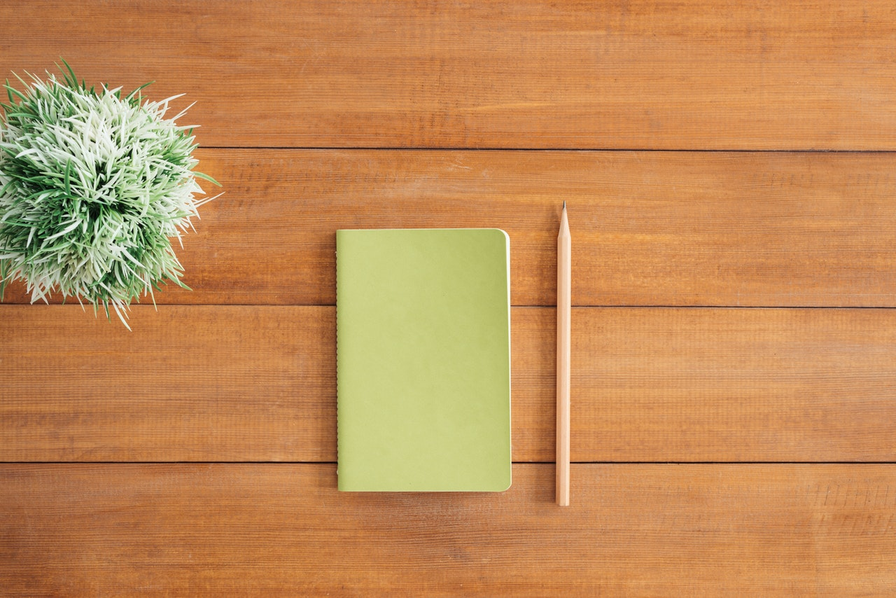 white-notes-beside-a-pencil-on-brown-wooden-surface-733854